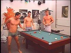 Topless guys play pool and strip naked