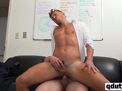 Stunning gay guy riding on stiff cock in office