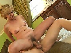 Nasty granny named Lili gets a young cock in her hairy and old pussy